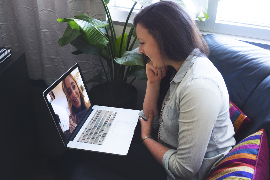 Girls talking on laptop